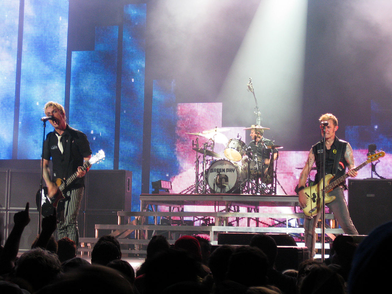 Green Day on stage at a show on their 21st Century Breakdown World Tour. Image via  Wikipedia .