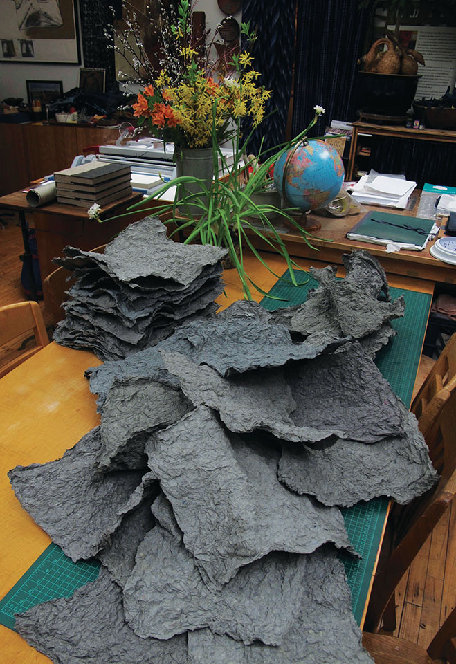 cascade-of-charcoal-colored-textured-mixed-fiber-paper.jpg