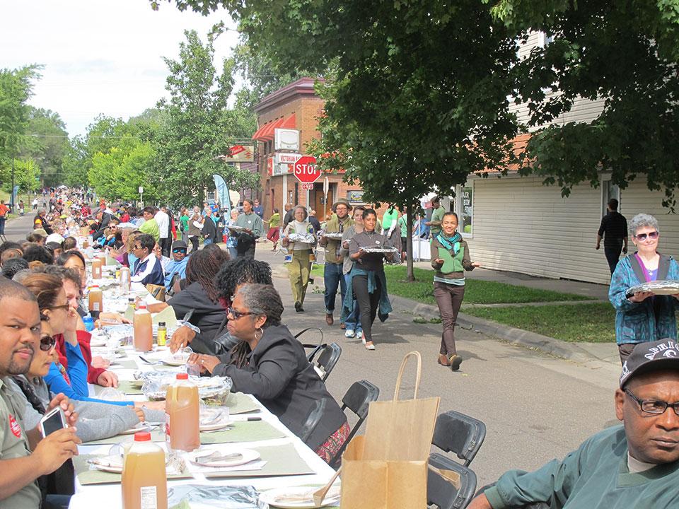 create-community-meal-dancers-delivering-along-half-mile-table.jpg