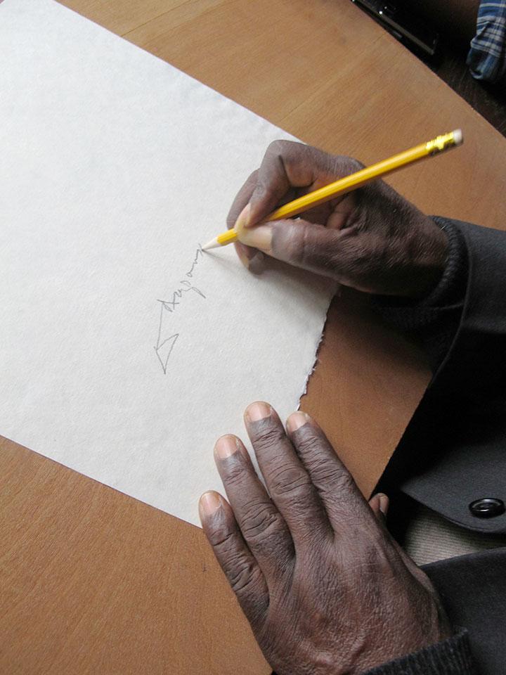 koo-nimo-signing-paper-pre-press.jpg