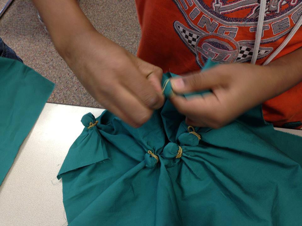 public-school-student-knotting-tie-dye.jpg