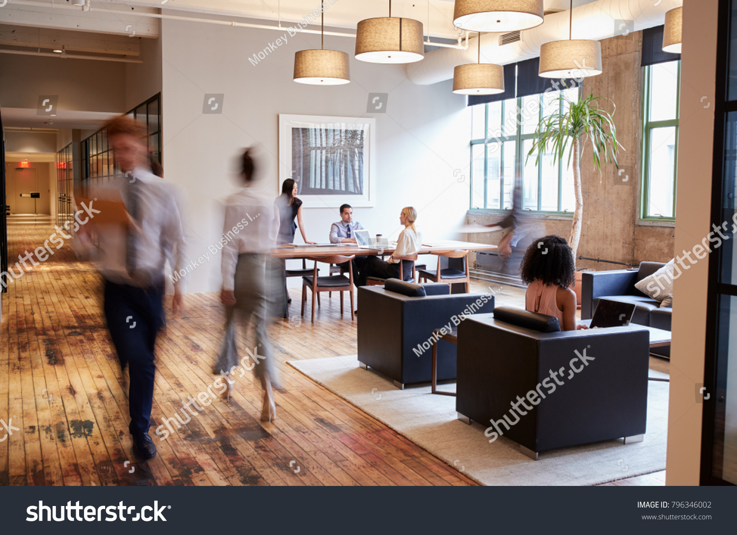 stock-photo-business-people-at-work-in-a-busy-luxury-office-space-796346002.jpg