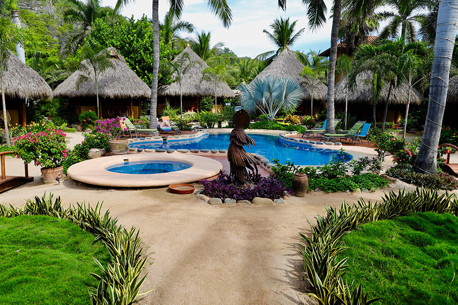 present-moment-side-view-pool-statue-lush-greenery-property-IMG_9449-900.jpg