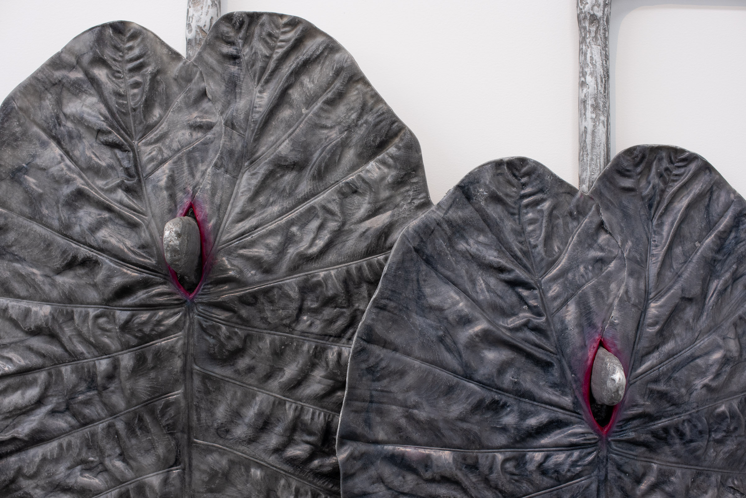 Karen Lofgren Detail:  Like This I See You in Dreams (como lo cura, locura),  2018 polyurethane castings of Amazonian medical plant leaves (la pataquina negra), aluminum powder, embedded wool, fiberglass, on cast aluminum 52 x 40 x 9 in (132.1 x 101.6 x 22.9 cm)