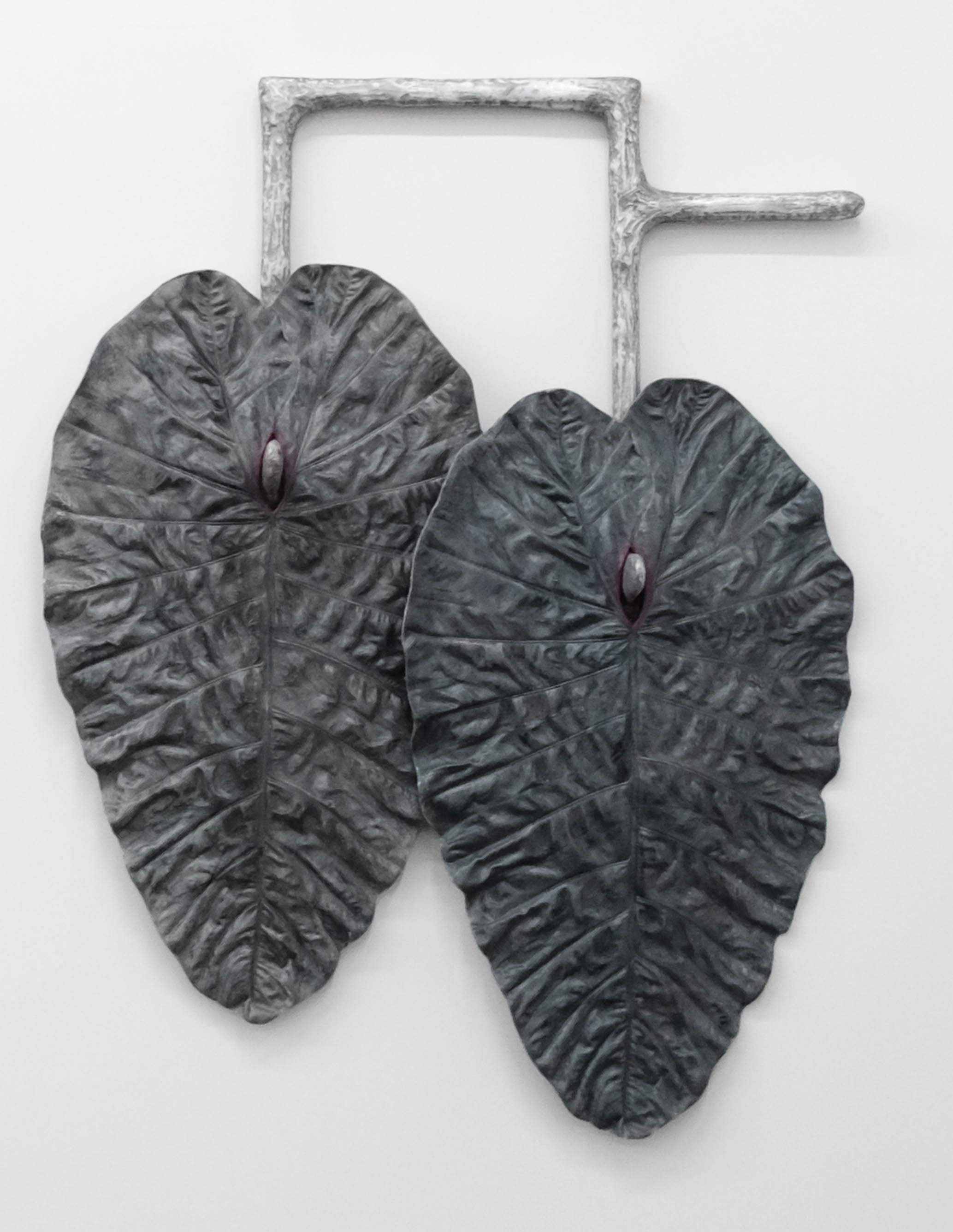Karen Lofgren  Like This I See You in Dreams (como lo cura, locura) , 2018 polyurethane castings of Amazonian medical plant leaves (la pataquina negra), aluminum powder, embedded wool, fiberglass, on cast aluminum 52 x 40 x 9 in (132.1 x 101.6 x 22.9 cm)