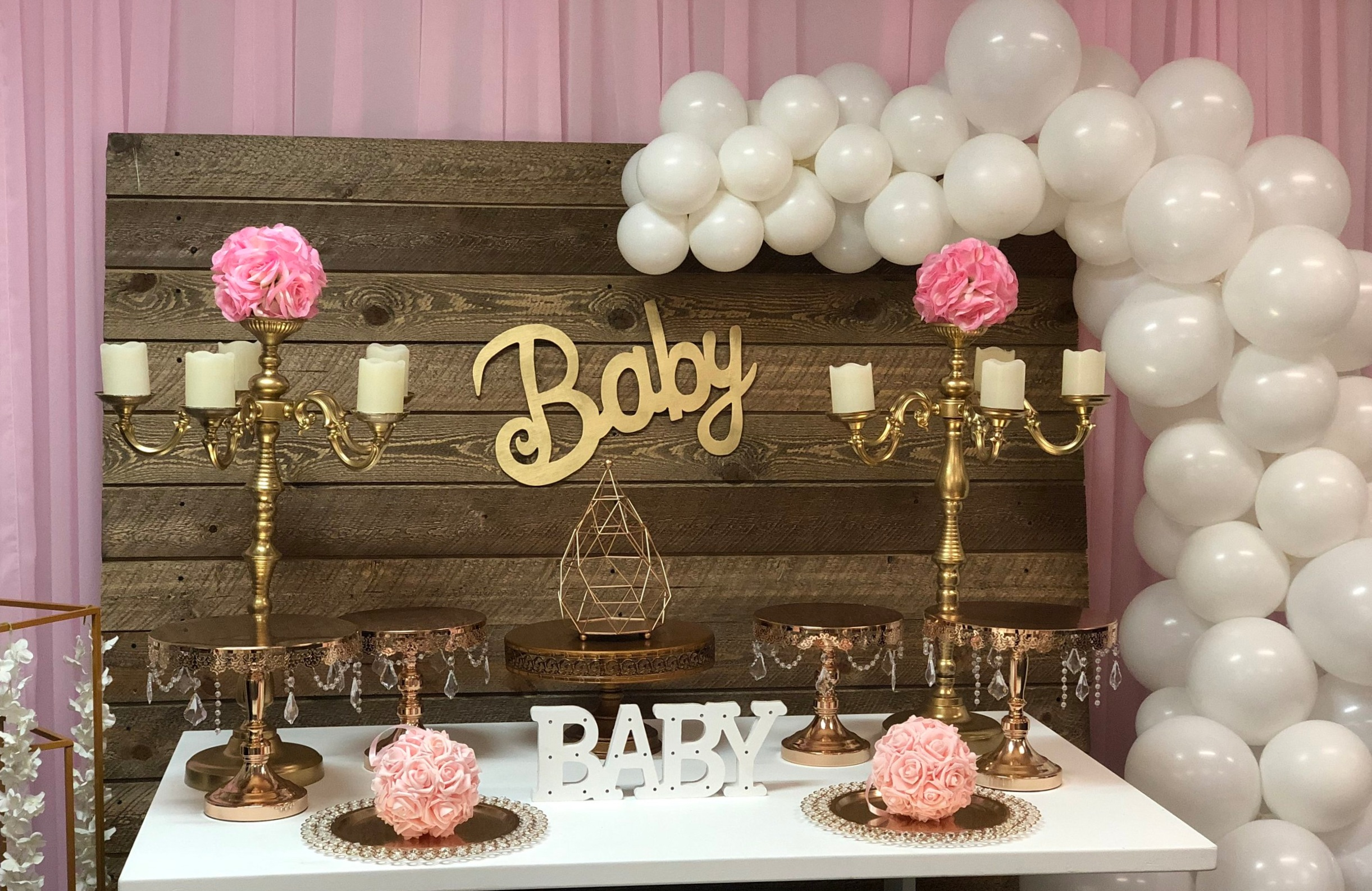 Rustic Wood Backdrop, Gold Candelabras, Gold Cake Stands, Balloon Garland, & Baby Signs
