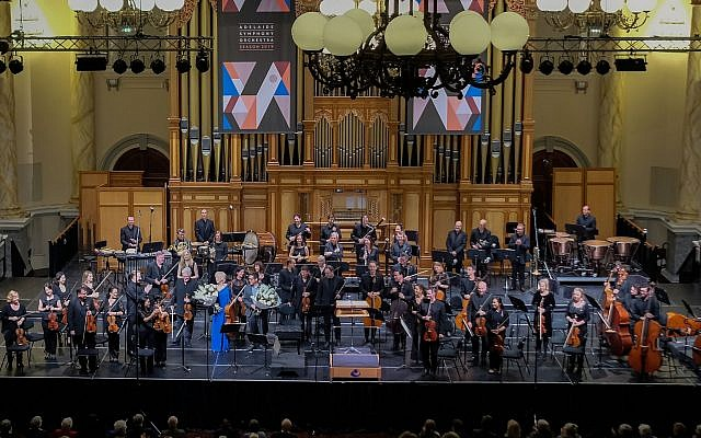 Pinchas Zukerman and Amanda Forsyth receive flowers at the end of the June 27, 2019 world premiere of Avner Dorman's 'Double Concerto for Violin, Cello and Orchestra,' with the Adelaide Symphony Orchestra (Courtesy/Kirshbaum Associates)