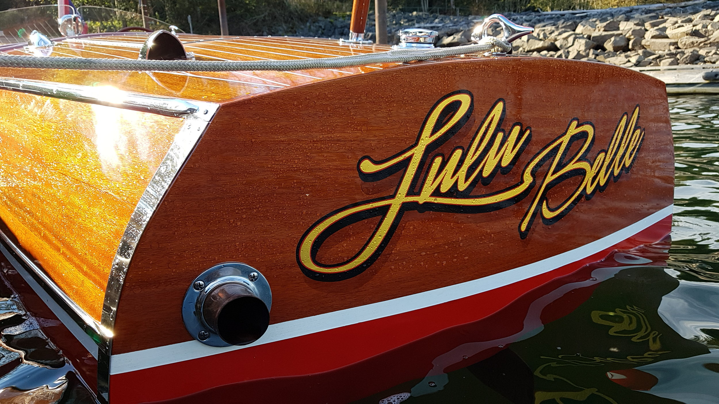 Lulu Belle is a 1942, - 17', Chris Craft Special Runabout. This is my first boat. It was a shipwreck when we bought it and I did a 3 year full restoration on it. My wife Louise, thought I was crazy and couldn't understand why I had to have a boat. But she does understand my consuming, obsessive, compulsive, behavior . She puts up with a lot so I wanted to name the boat after her but she wouldn't have it! So how do you name the boat after her without putting her name on it? Well… Lulu Belle is what her Dad called her when she was little.By Steve Leslie