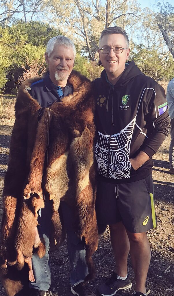 "Paul with Uncle Richard Kennedy (dressed in a possum cloak) who is descendent of Dick-a-Dick who toured in the inaugural UK tour in 1868 with the Aboriginal team. This image was taken at ""Johnny's Waterhole""."