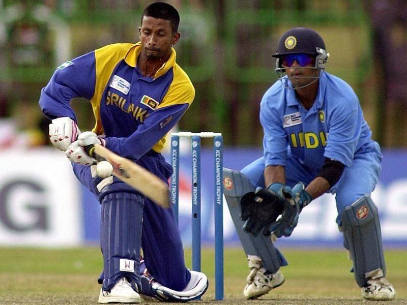 Image: Russel Arnold playing the sweep shot against India in a ODI. AAP