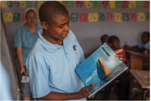 Educating the local community. Photo: Jeff Hester - Photographers Without Borders