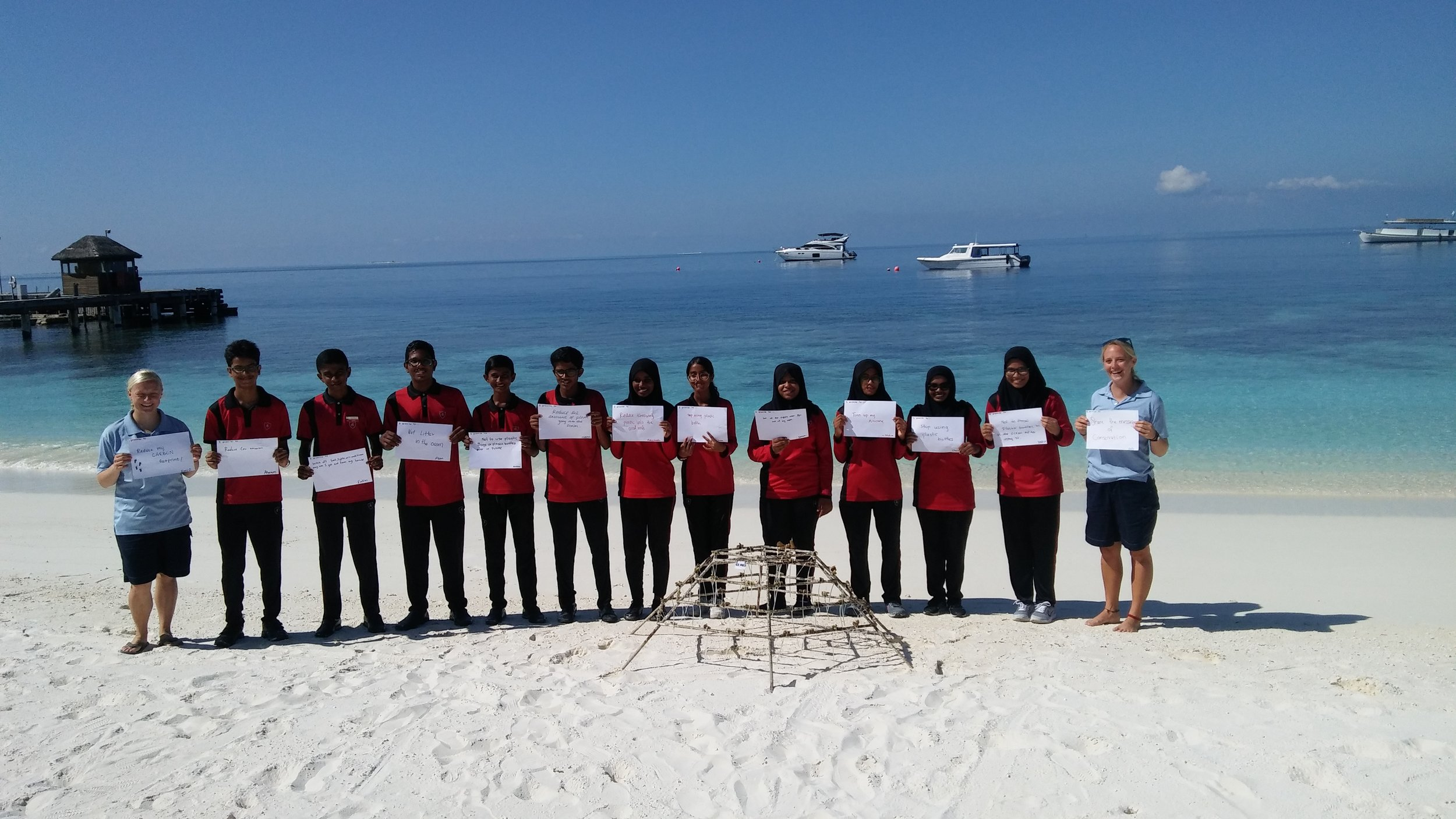 Coral propagation with a group of students for world Tourism day; training for coral propagation program. Photo: Emily Moxham @sustainablemoxi