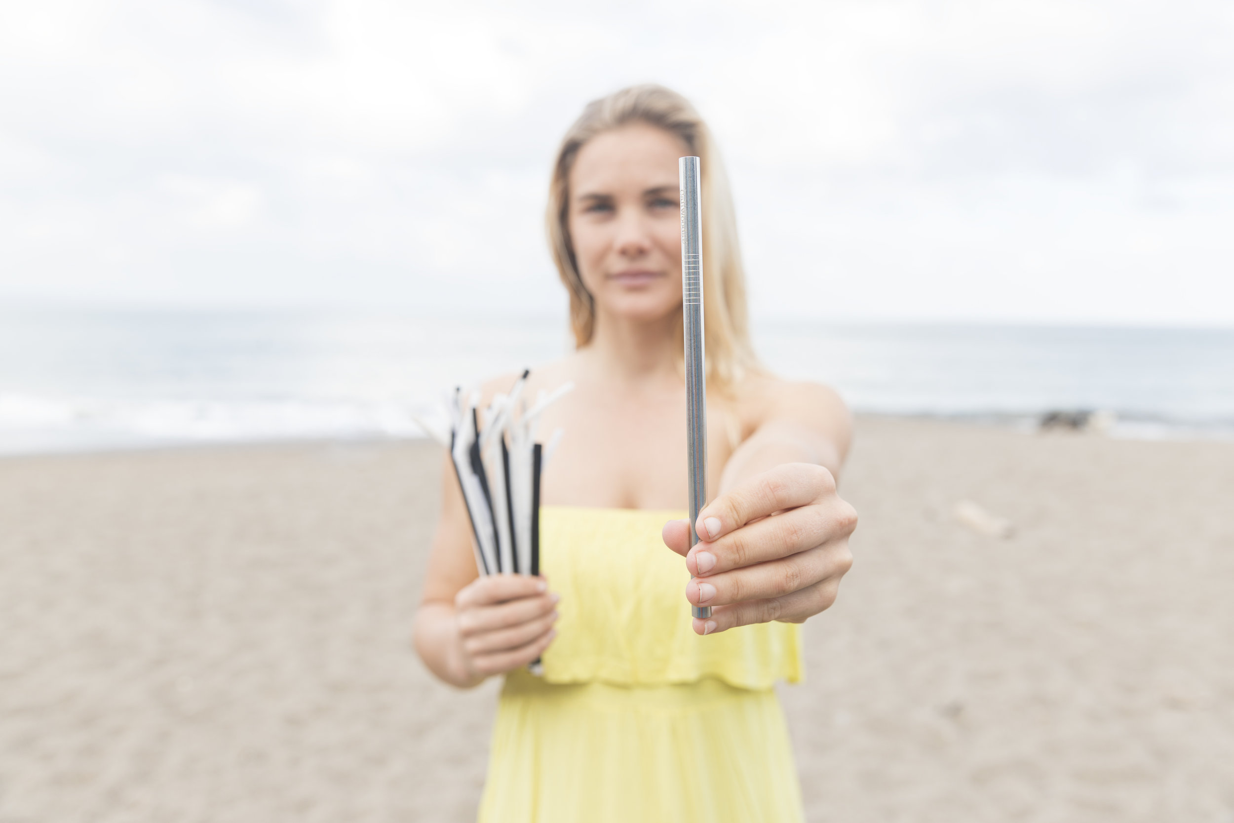 Shay Lawrence holding the product that started it all: reusable straws. Photo: CaliWoods