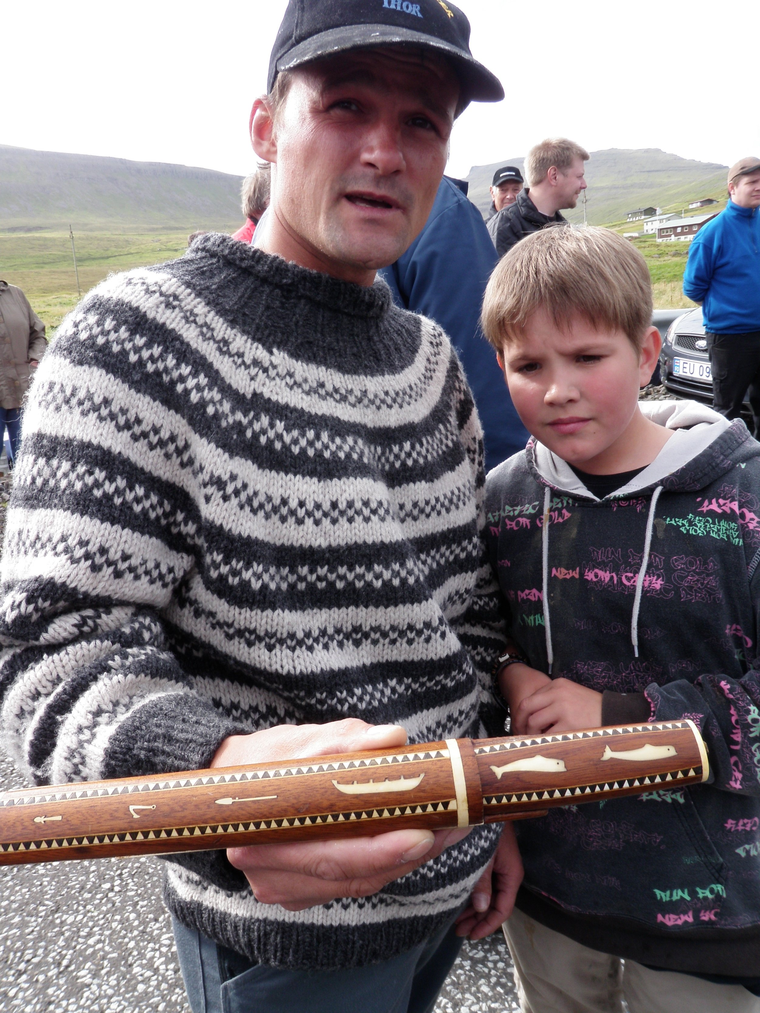 Local man holding a Farose whaling knife. Photo: Russell Fielding