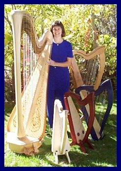 Cindy Blevins, surrounded by harps.