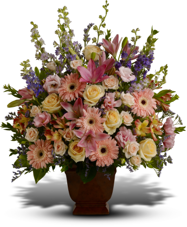 Loving Grace    Honor a beautiful person with a beautiful bouquet. This dramatic display of blooms features flowers such as peach roses, light pink spray roses, pink asiatic lilies, pink gerberas, pink alstroemeria, pink lisianthus, lavender and purple larkspur, purple limonium and greens including myrtle and salal.    Buy Now>>
