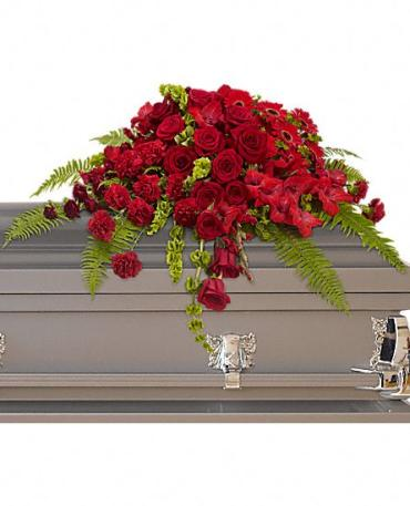 Red Rose Sanctuary Casket Spray    A gorgeous mix of dazzling red flowers will make a grand, yet graceful impression. Beautiful red roses, spray roses, gerberas, gladioli and carnations along with vibrant green bells of Ireland create a sincere tribute.    Shop Now>>