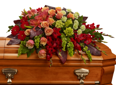 A Fond Fare Well Casket Spray    An overflowing of love and respect is joyfully expressed in this truly magnificent casket spray of orange roses and lilies and other brilliant blooms.    Shop Now>>