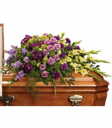 Reflections of Gratitude    Beautifully expressed with lavender roses, purple alstroemeria and other favorites artistically arranged and placed on top of the casket.    Shop Now>>