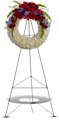 Reflections of Glory    A distinctive sympathy wreath of traditional flowers such as red roses and gladioli, bright white chrysanthemums, and proud blue hydrangea and delphinium.    Shop Now>>