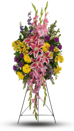 Rainbow Of Remembrance    Your sincere wishes for peace and harmony resonate beautifully in this perfectly balanced arrangement of pink lilies, yellow gerberas and purple larkspur.    Buy Now>>