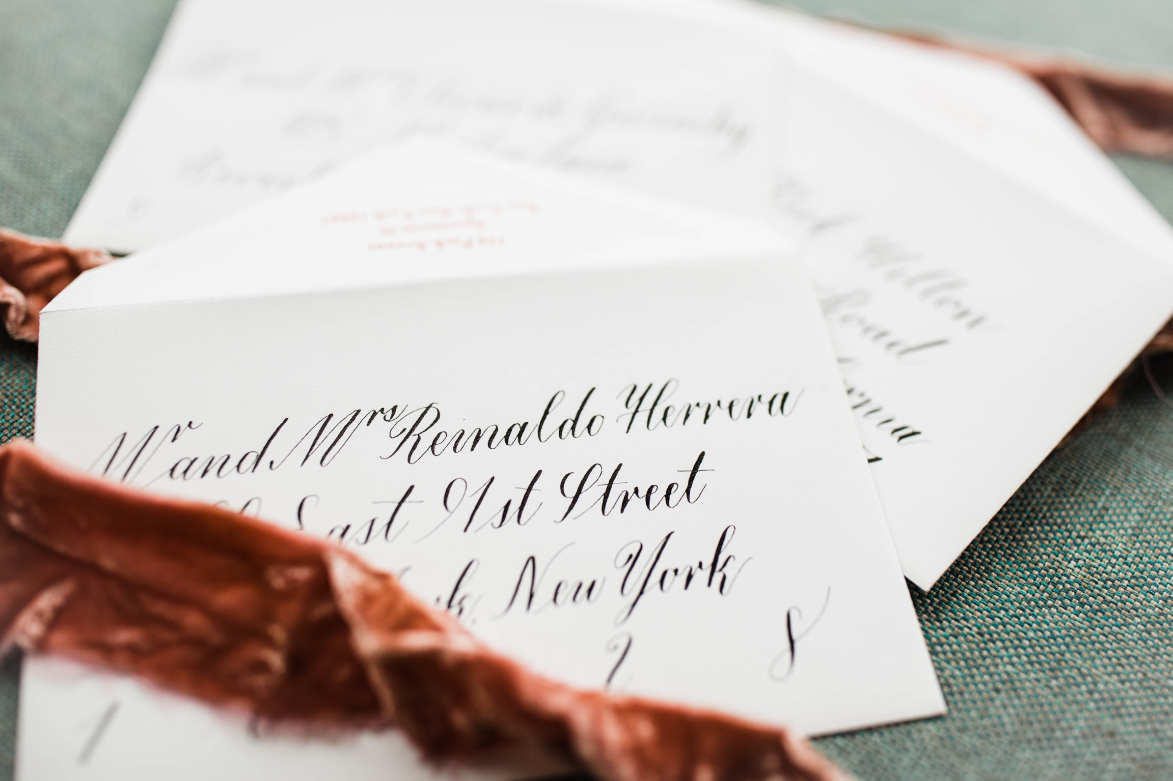 These envelopes were hand lettered in Traditional Copperplate style for an event in the New York area.  The envelopes set the tone for the gorgeous event that took place in February of 2019.