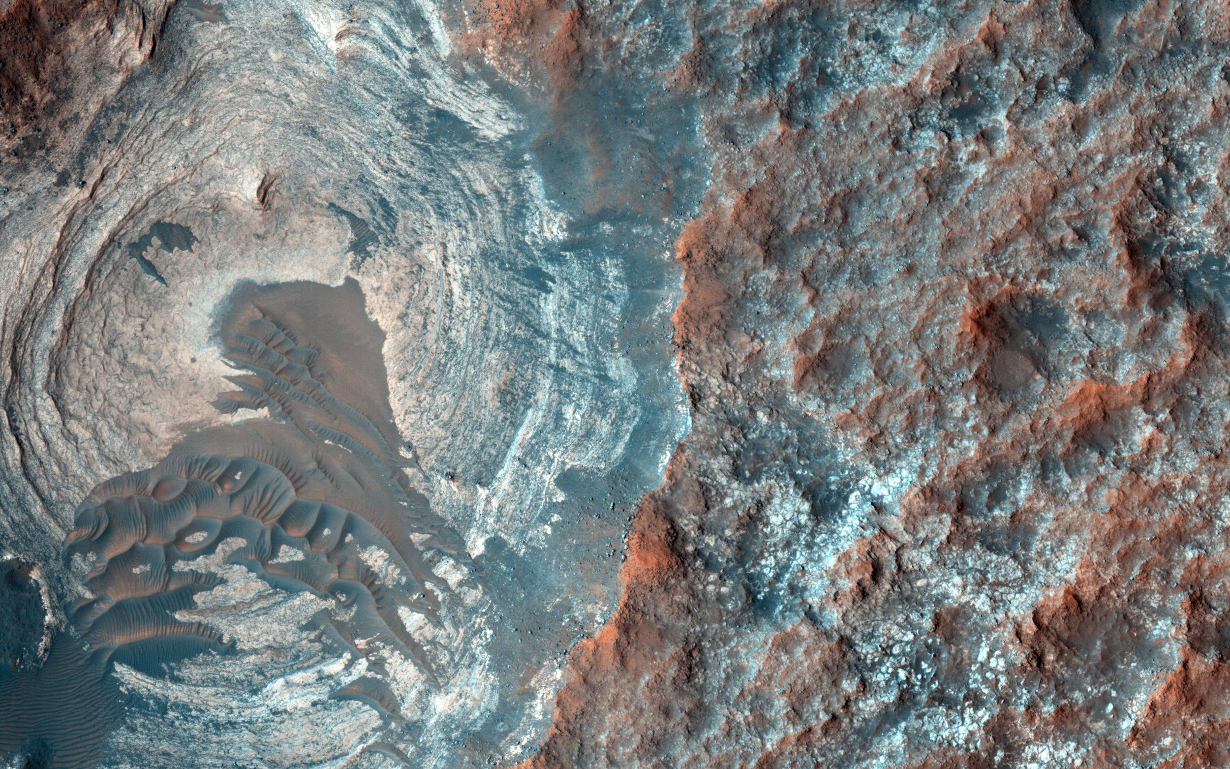The Martian surface, from orbit, doesn't appear too dissimilar from Earth. Photo credit: NASA