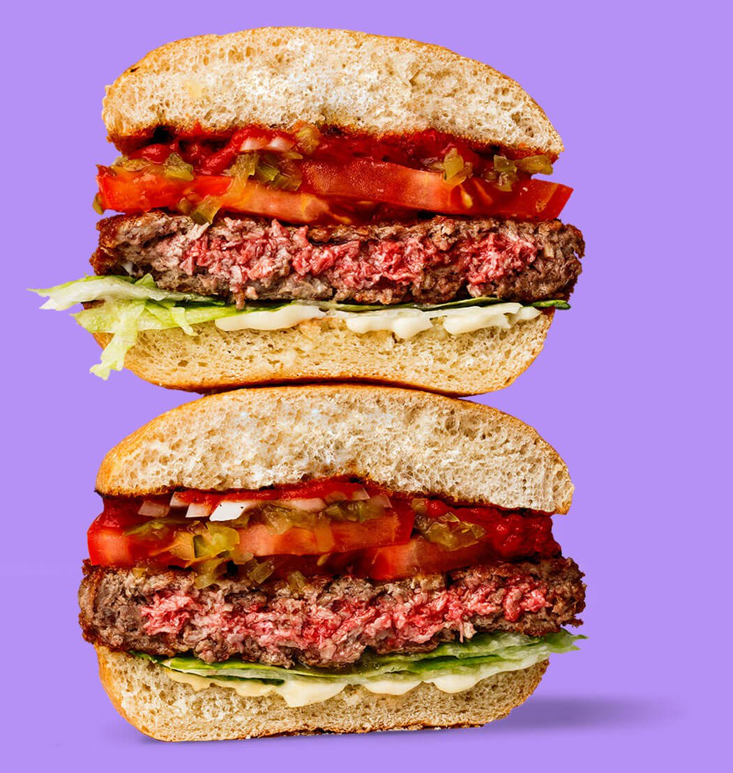 Despite how it looks, this burger is 100% vegan, made with algae that produce bovine heme and giving it a bloody look. Photo credit: Impossible Foods