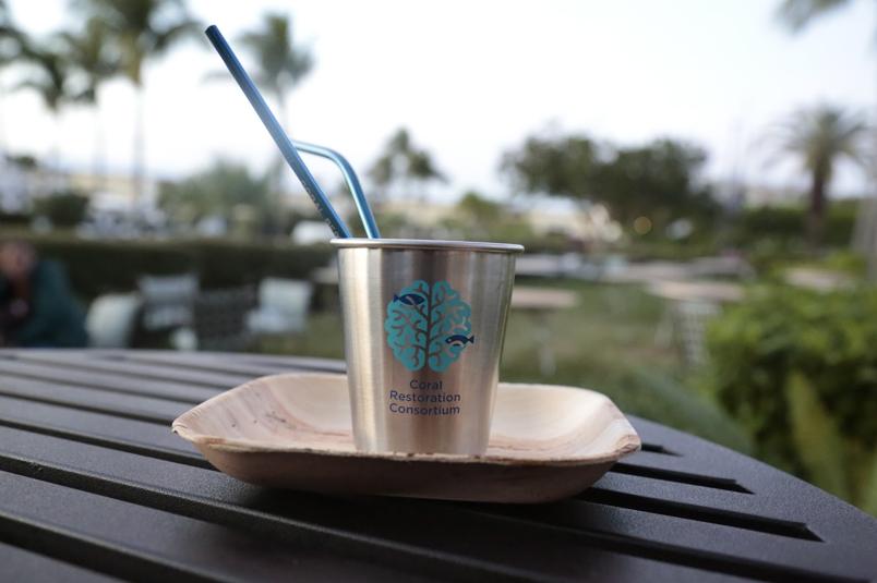 No single-use plastics were used at the conference. Attendees were given a stainless steel cup and straws, and food was served on bamboo plates. Photo by Sara Nilsson, Coral Restoration Consortium.
