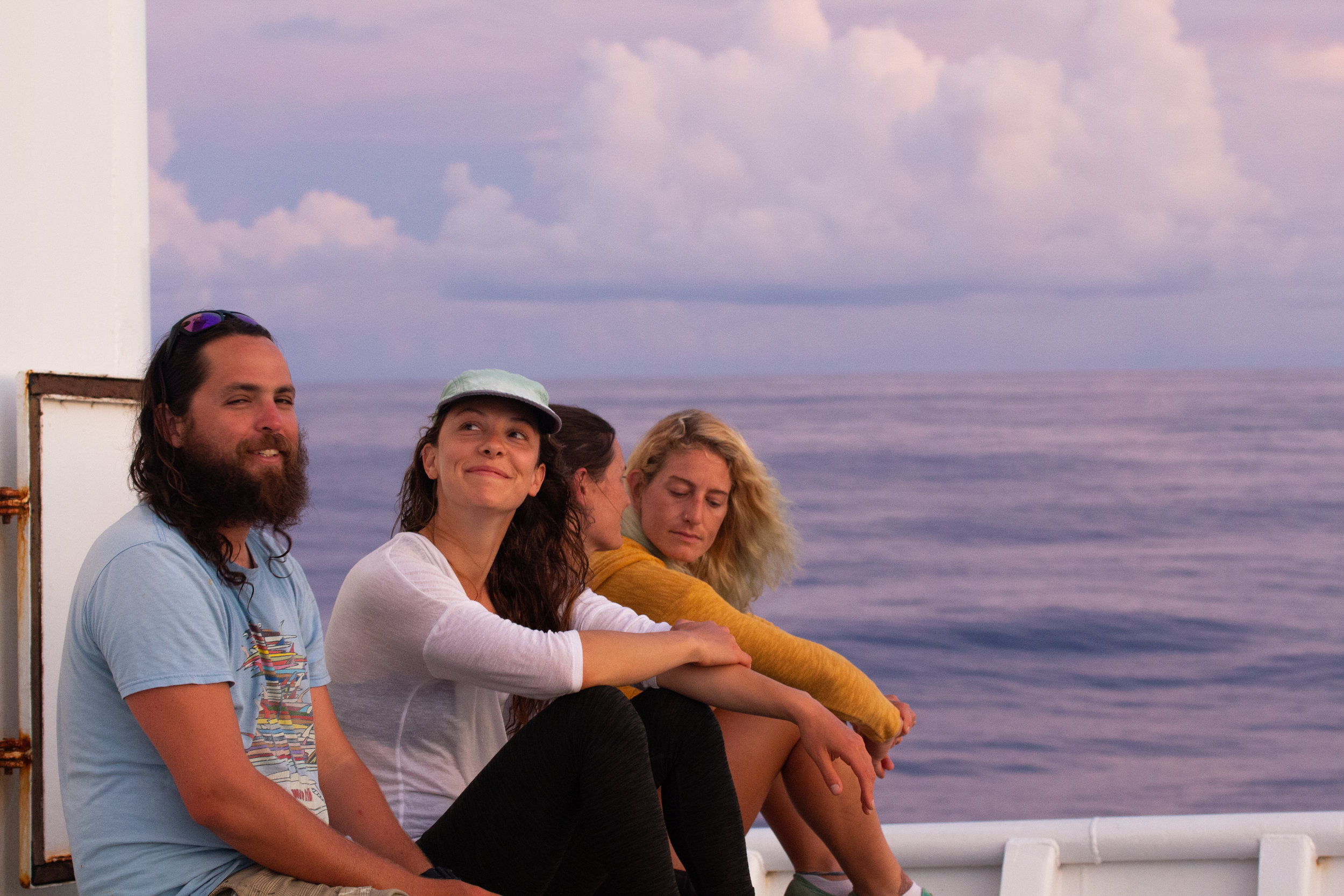 Some battle-worn grad students enjoying a sunset on a research cruise in American Samoa. Photo credit: Kevin Green