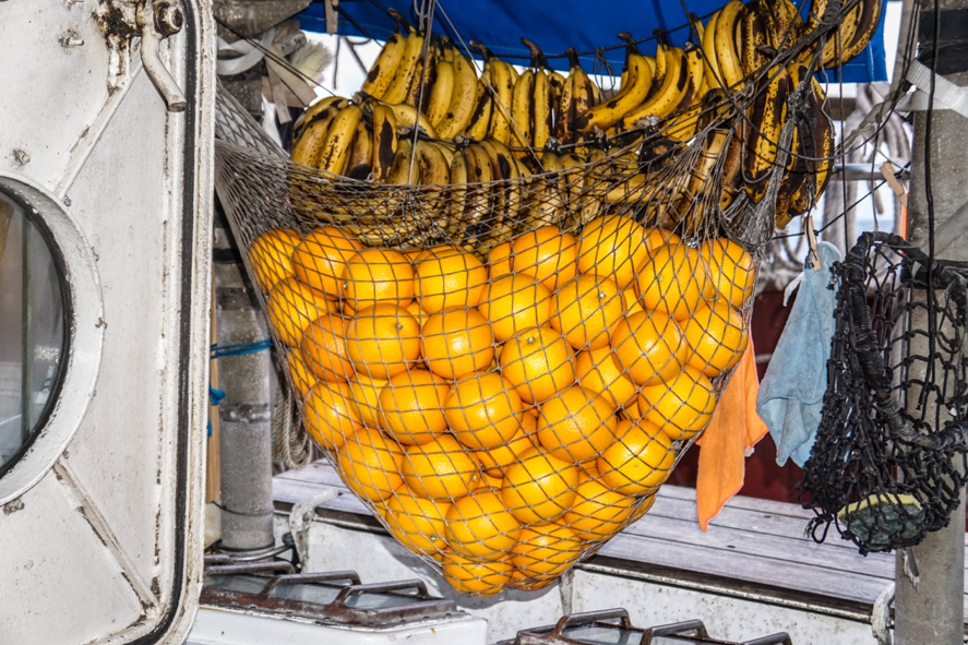 Citrus fruit (oranges) is stored on the main deck to prevent from molding below deck or ripening too quickly – the salty air also can act as a natural preservation agent! Photo credit:  Jared Moelaart
