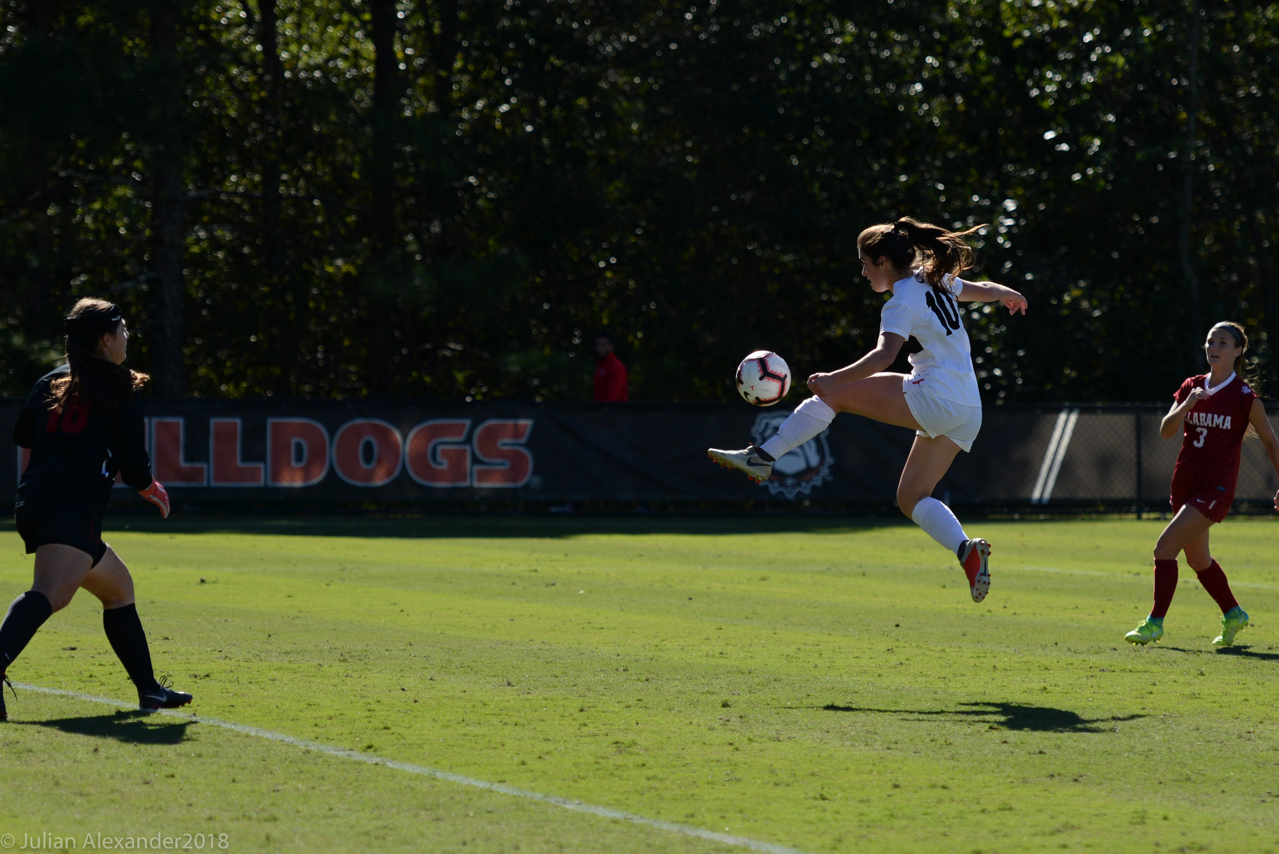 University of Georgia forward Delaney Erwin (10) kicks the ball for a shot during a match against the Alabama Crimson Tide on Oct. 21, 2018 at the Turner Soccer Complex in Athens, Georgia. The Dawgs and Crimson Tide finished the match in a draw 1-1 in double overtime. (Photo/Julian Alexander)