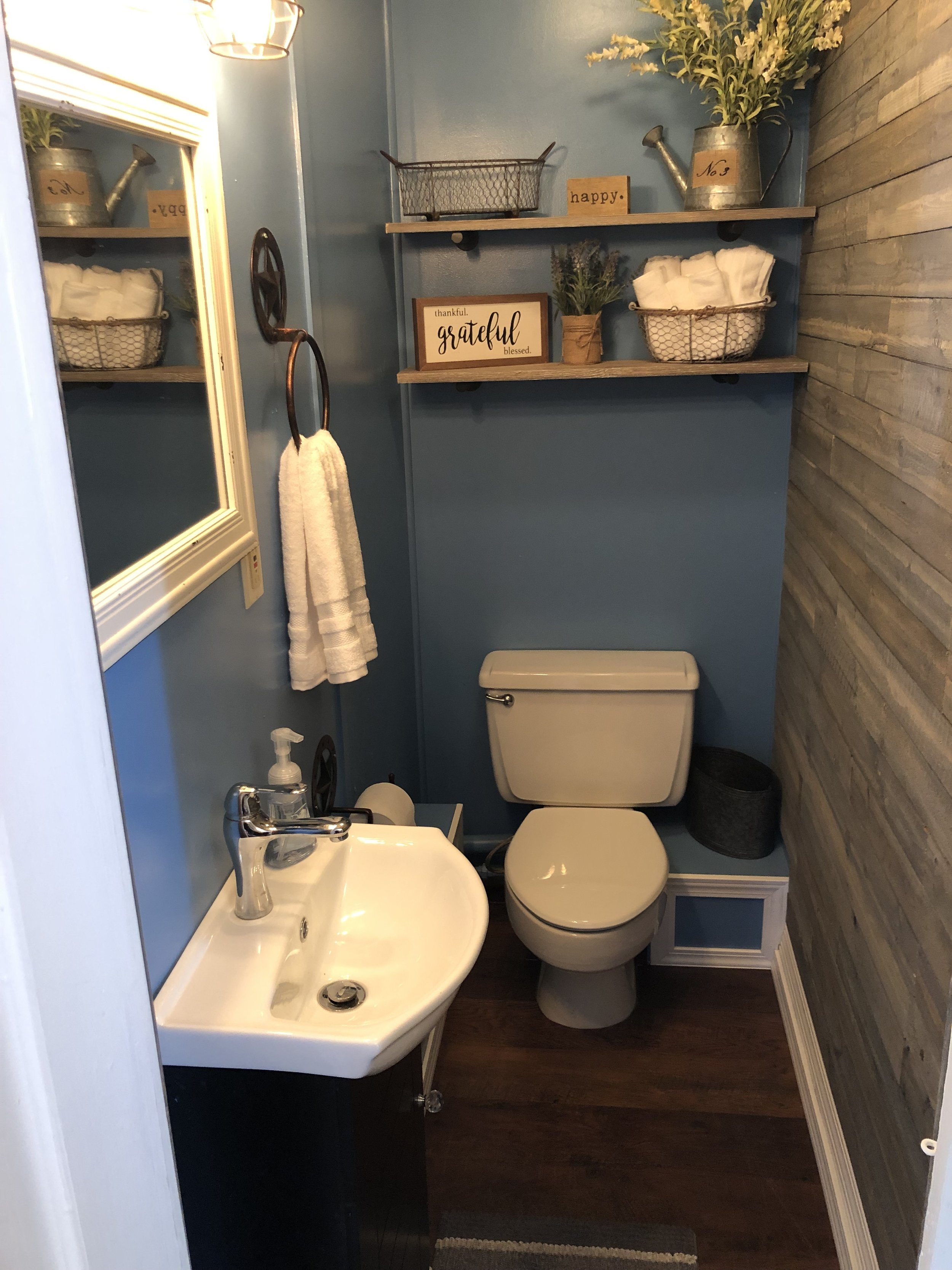 A cozy toilet room, separate from the larger shower room.