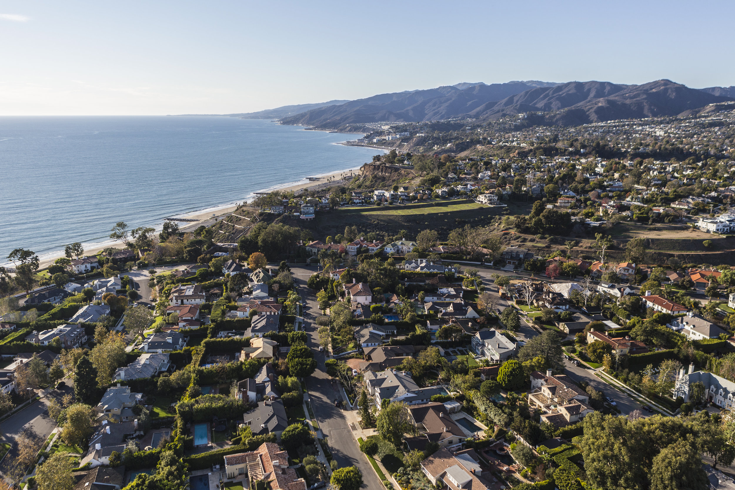 Pacific Palisades - This affluent residential neighborhood is tucked between the Santa Monica Mountains and the Pacific Ocean. Temescal Gateway Park offers hiking trails with sweeping coastline views, and the sandy Will Rogers State Beach provides access to a 22-mile beachfront bike path.