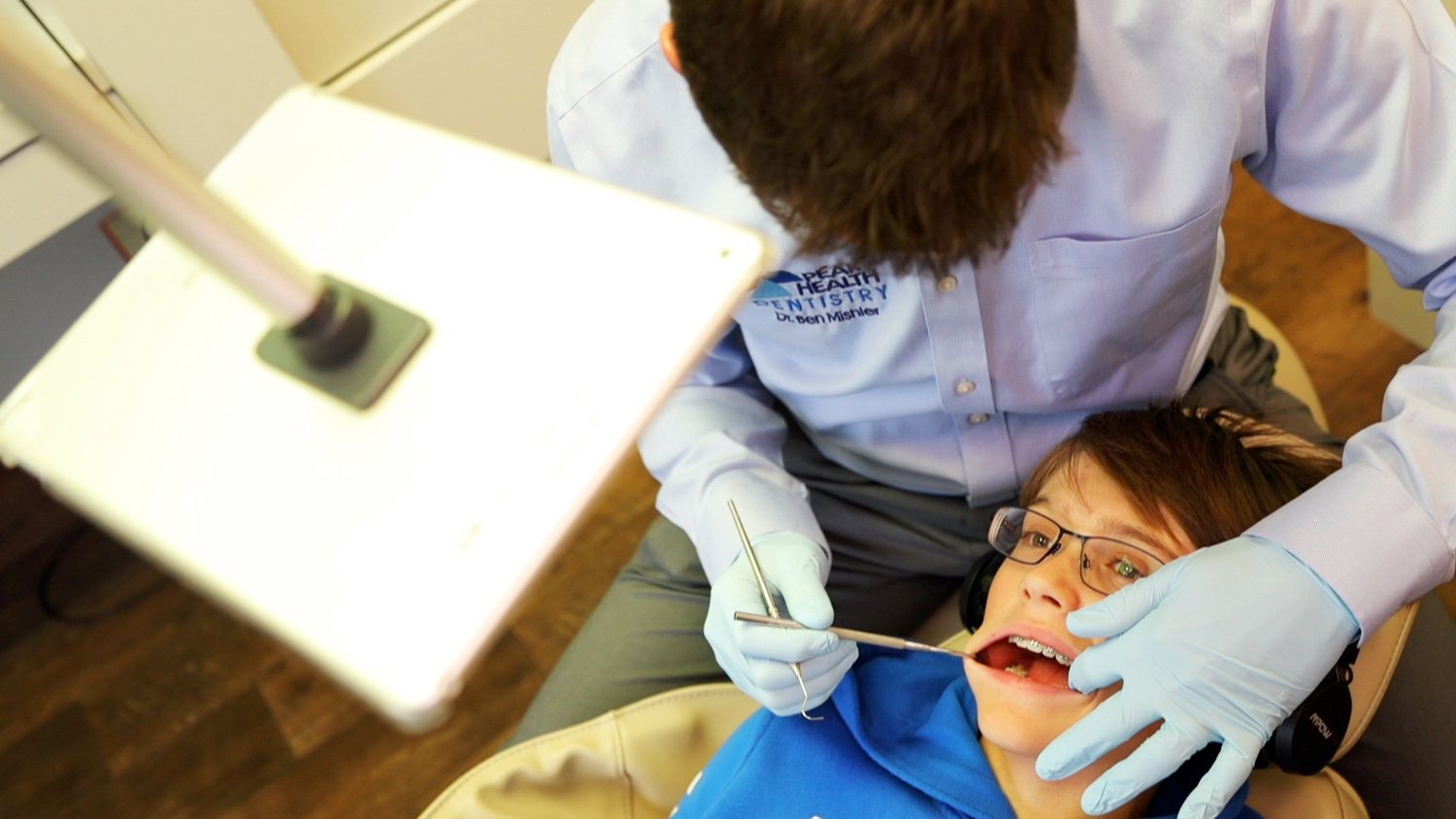 We have video players for patients to watch during their dental exams!