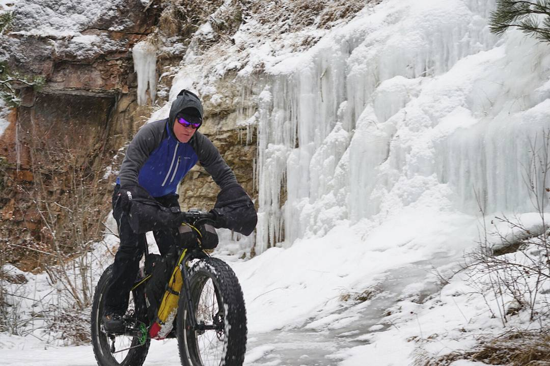 Winter adventure abounds! Here's  Perry Jewett  cruising across a frozen waterfall on his FatBack Corvus and studded 45NRTH Dillinger 5 tires. (Photo by  Zach Stone , January 2018)