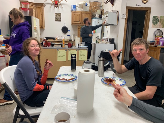 Joel and I stuffing our faces full at the Man Cave while Tracy and the other Volunteers kept us all going. Every time I see these photos I have to laugh—ultra endurance racing is not a flattering sport. Photo by Perry