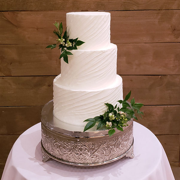 Elegant White Wedding Cake with Greenery