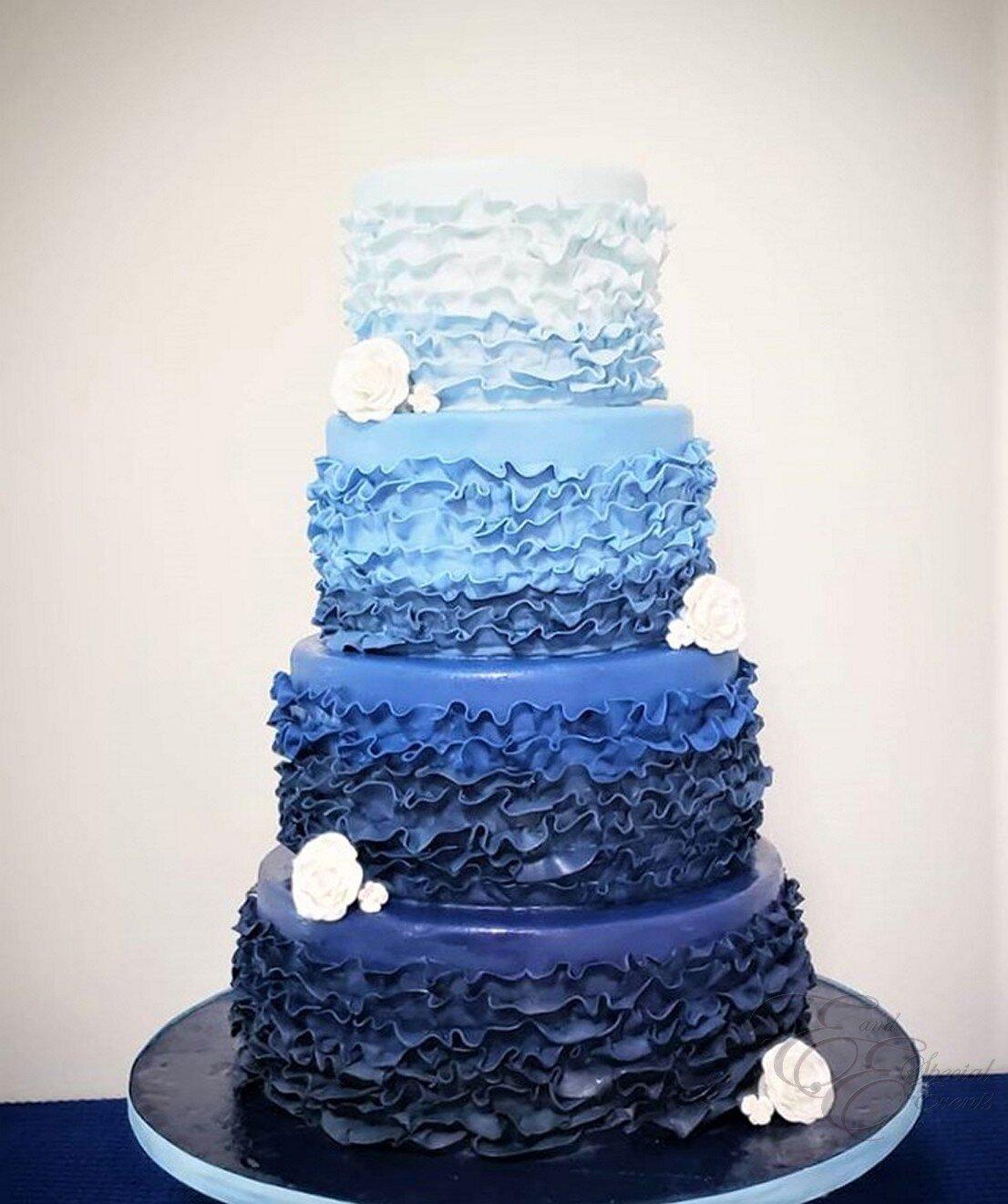 blue ombre wedding cake with fondant ruffles.jpg