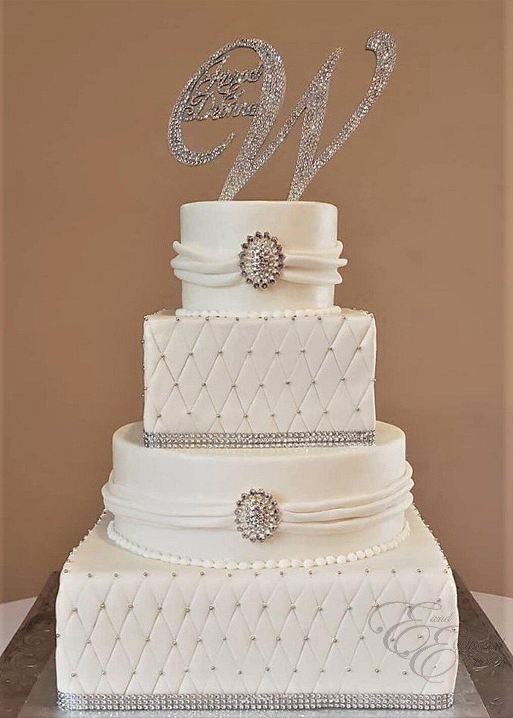 elegant white and silver wedding cake.jpg