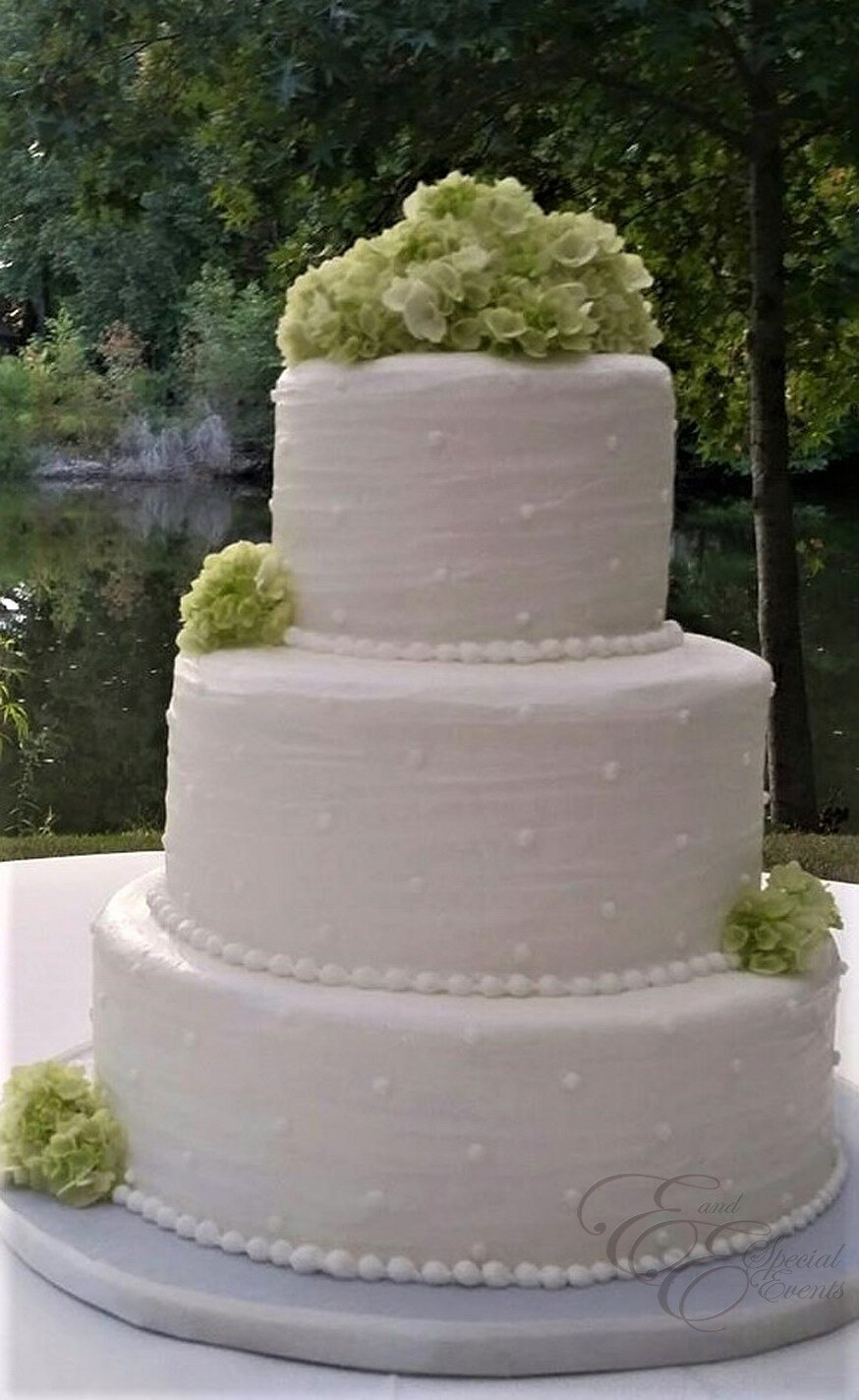 white wedding cake with green flowers.jpg