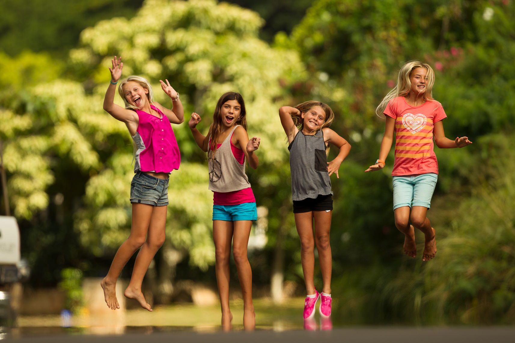 kids girls jumping oahu hawaii family sisters photo