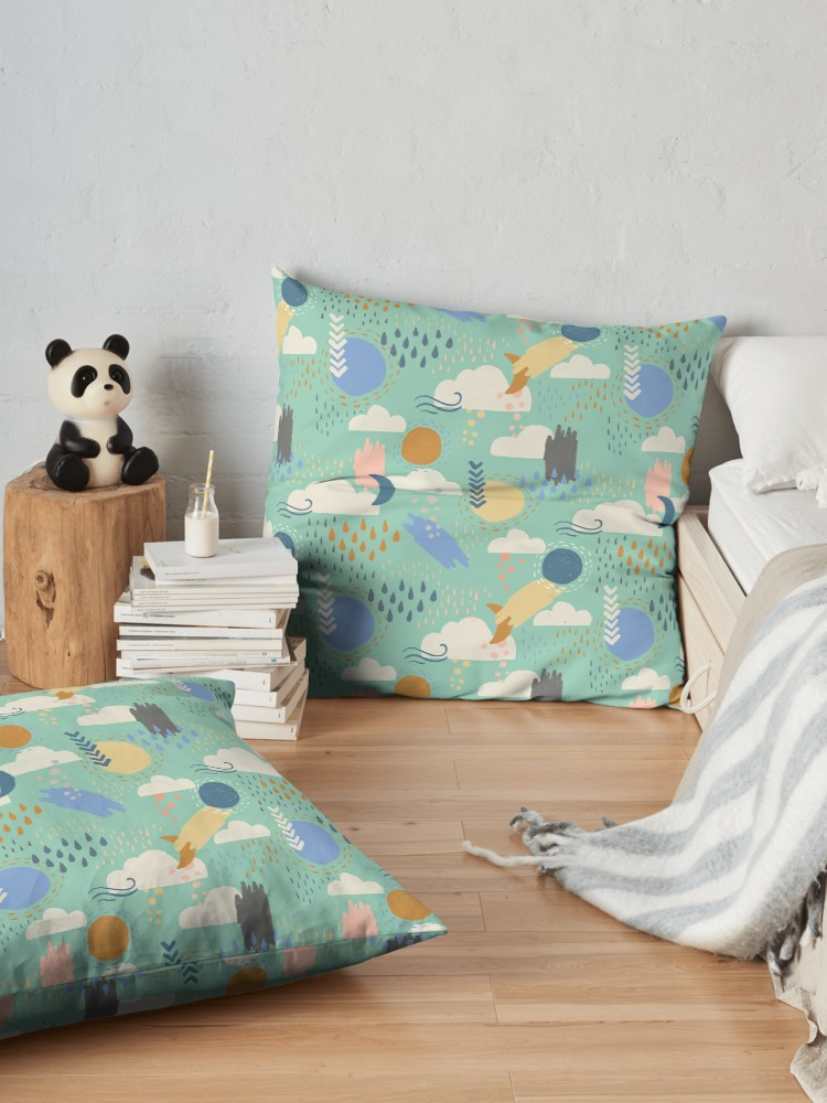 Aqua, blue, yellow, and pink colored pillow cases perfect for a gender neutral nursery.