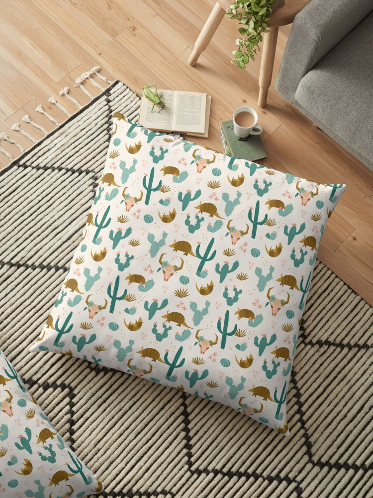 Reading pillow with cute armadillo and boho style skull with gold and teal elements