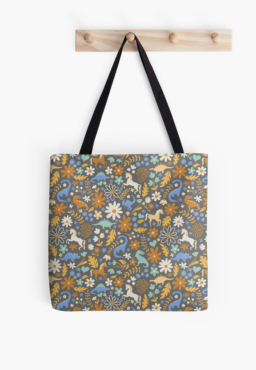 Tote bag of cute illustrations of my favorite dinos and in blue and umber