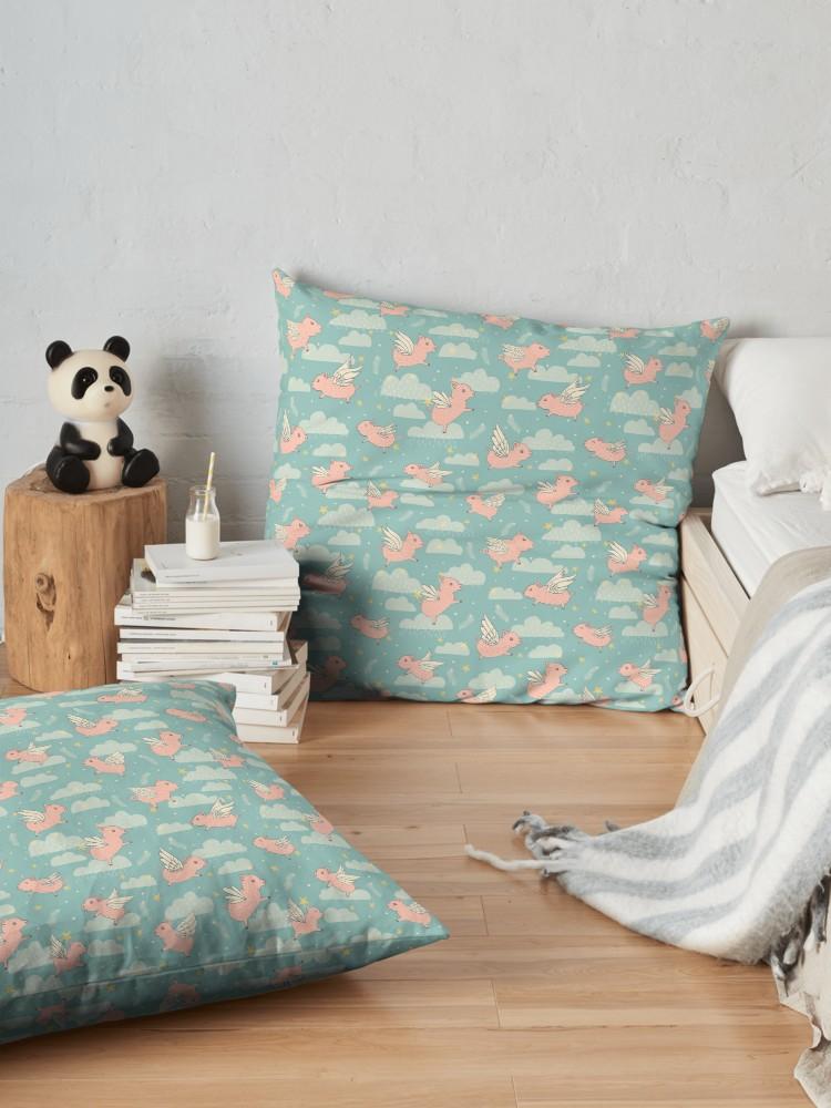 Cute nursery style floor pillow of flying pigs