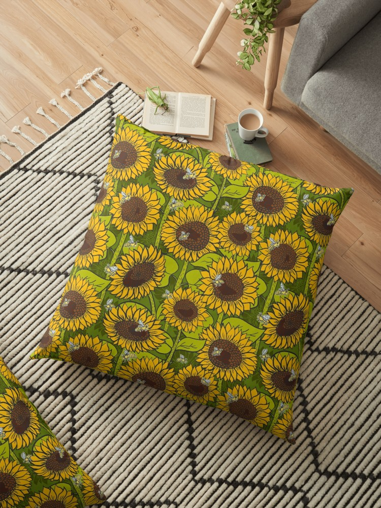 Floor pillow of bright yellow sunflowers in a green field. great for reading or lounging