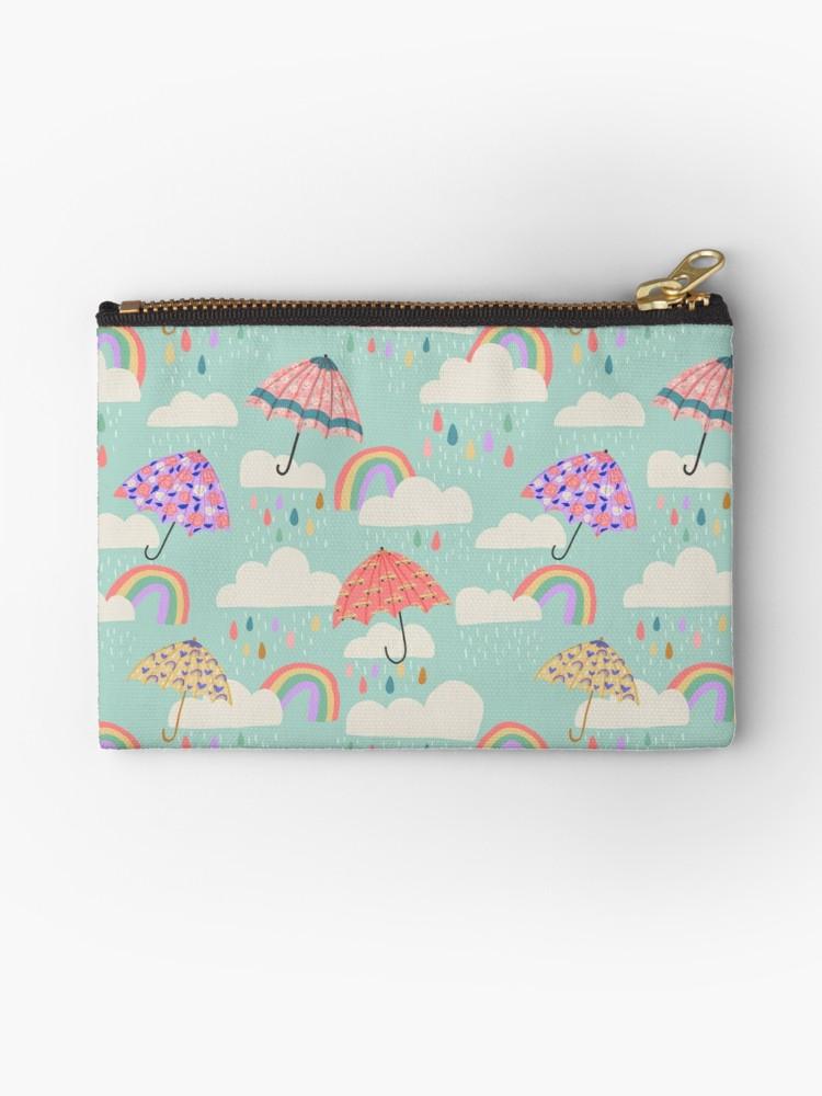 Cute aqua pattern of rainbow rain clouds with floral umbrellas