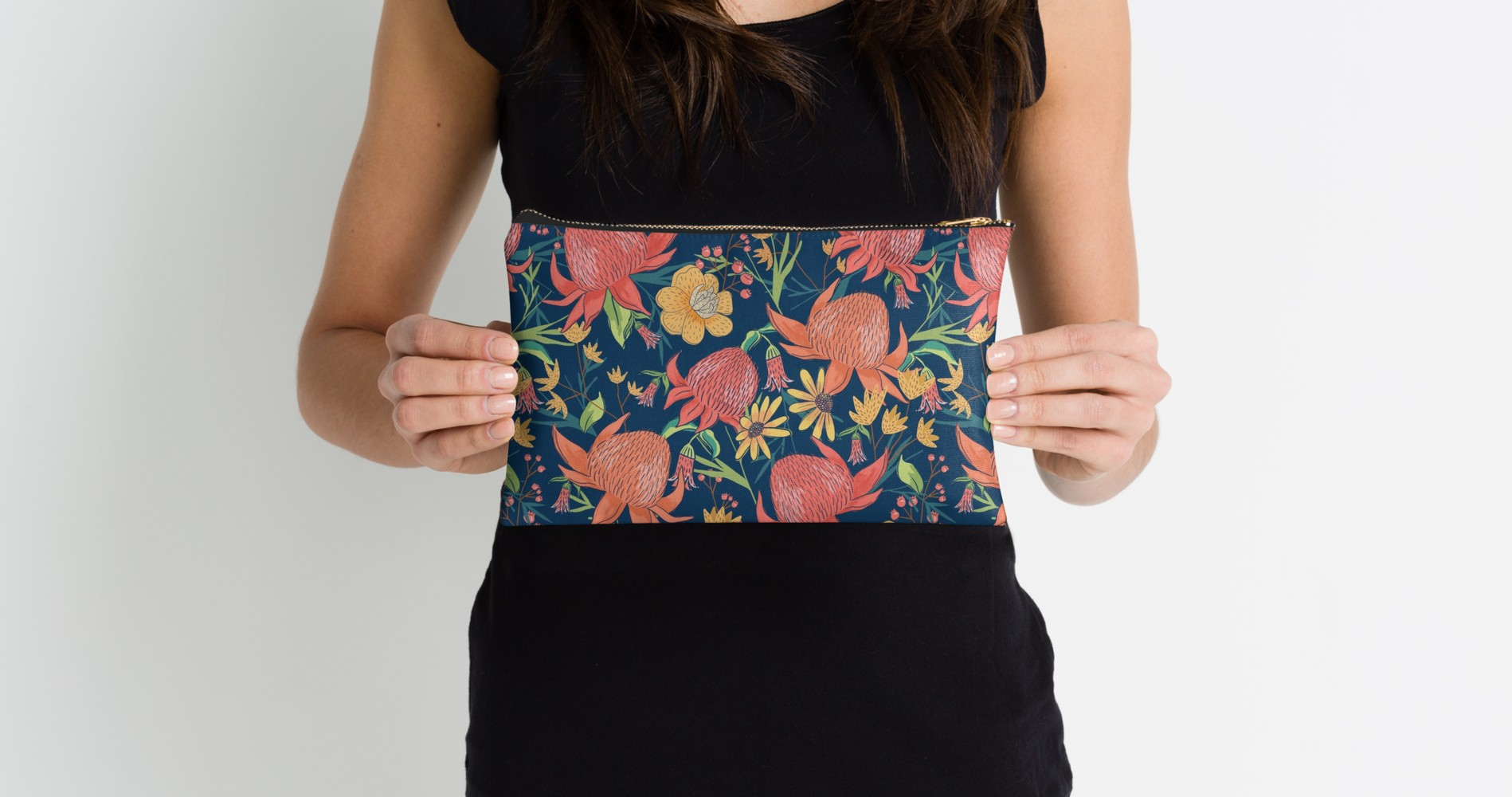 Blue floral pouch with red, coral, orange, and yellow native flowers to Australia.