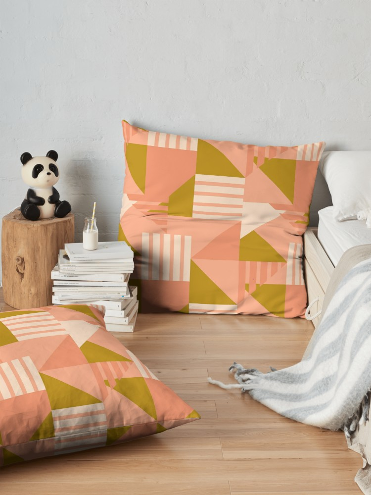 Large floor pillows look great in these pink and gold color blocks.